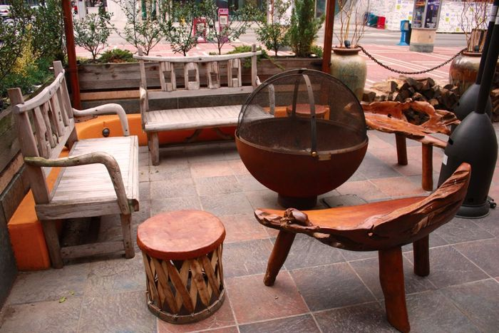 firebowl and wooden benches at Nada resaurant