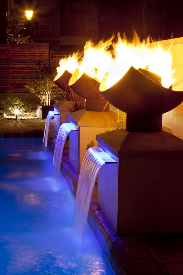 fountain with high end fire pits on pillars
