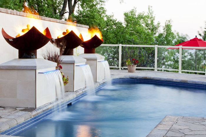 fire fountain by pool with pedestals