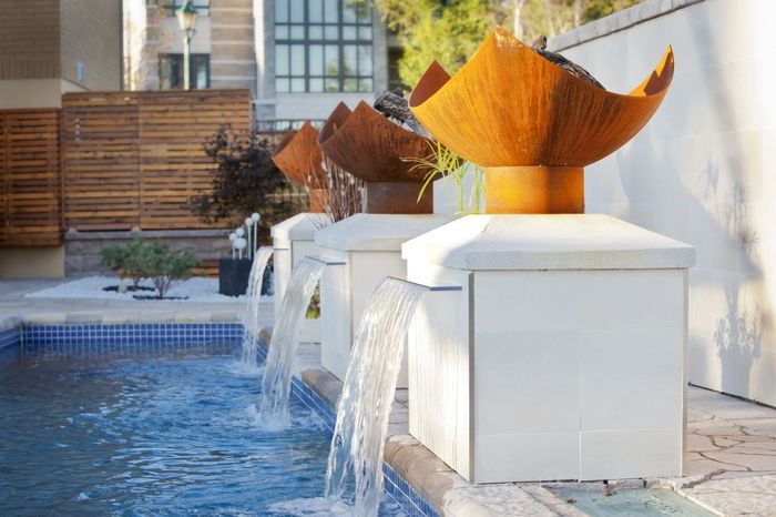 steel and stone fountain with fire element