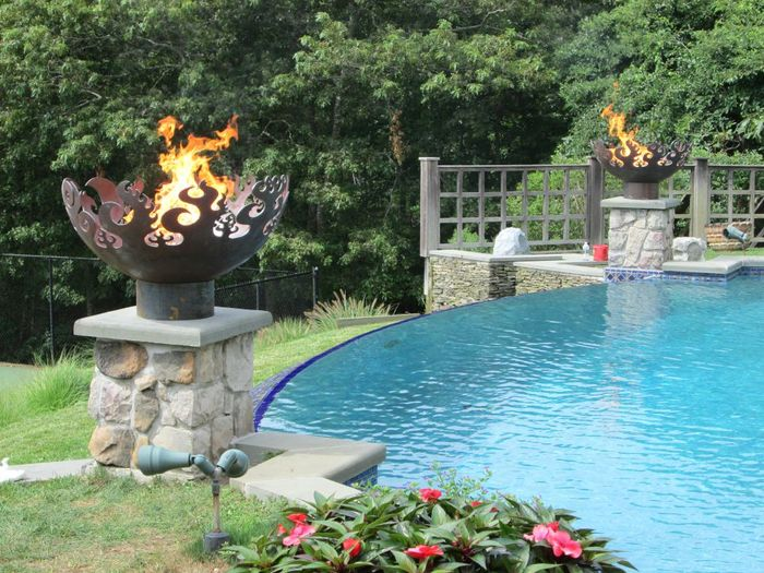 Fire Features and pool at Wilzig Castle, an estate in Water Mill, NY